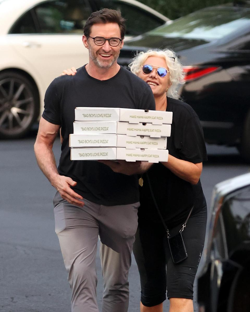 <p>Hugh Jackman and wife Deborra-Lee Furness pick up a couple of pizza pies in the Hamptons on July 20.</p>