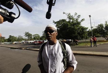 William Potts speaks to reporters outside Havana's Jose Marti International Airport, before boarding a plane to the U.S.