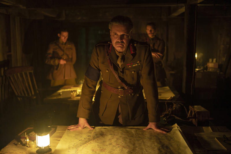 "This image released by Universal Pictures shows Colin Firth as General Erinmore in a scene from ""1917,"" directed by Sam Mendes. (François Duhamel/Universal Pictures via AP)"