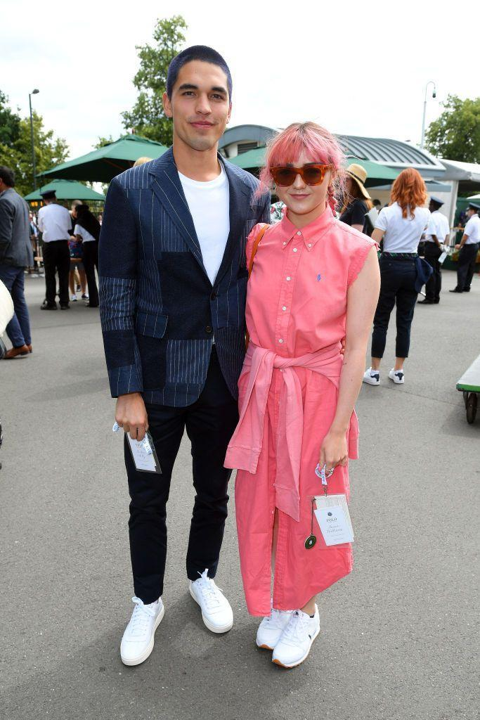 <p>A week after attending best friend Sophie Turner's wedding, Maisie Williams and boyfriend Reuben Selby arrived at Wimbledon. </p><p>The cool-as-can-be couple had their hair dyed bright colours (Maisie pink and Reuben purple) for the visit with Maisie extending the pink vibe to her Polo Ralph Lauren shirt dress too.</p>