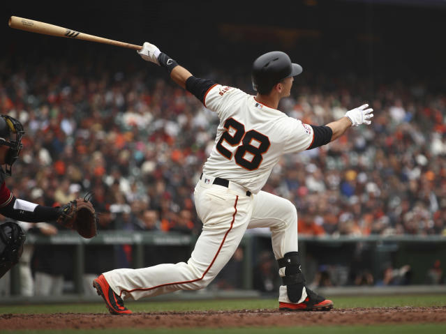 San Francisco Giants' Buster Posey swings for a two run home run off Arizona Diamondbacks' Robbie Ray in the fifth inning of a baseball game Wednesday, April 11, 2018, in San Francisco. (AP Photo/Ben Margot)