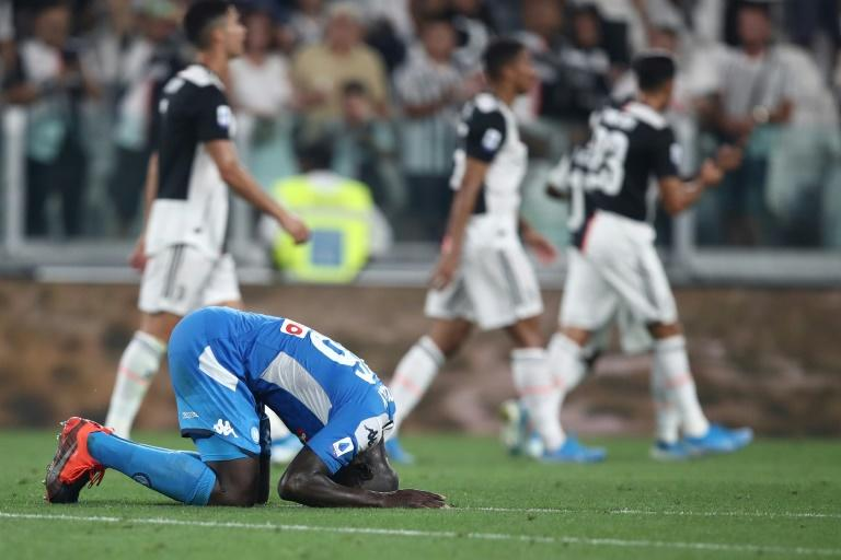 Senegal defender Kalidou Koulibaly reacts after conceding the own goal that condemned Napoli to defeat at Juventus