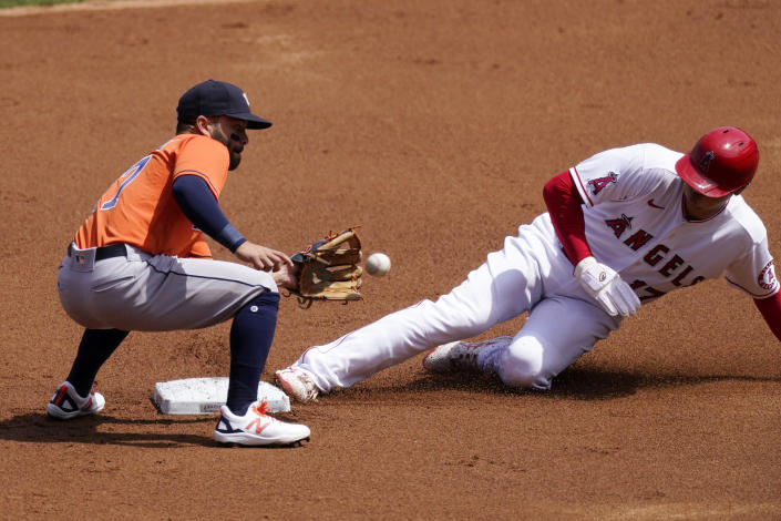 Los Angeles Angels' Shohei Ohtani, right, steals second as Houston Astros second baseman Jose Altuve takes a late throw during the first inning of a baseball game Tuesday, April 6, 2021, in Anaheim, Calif. (AP Photo/Mark J. Terrill)