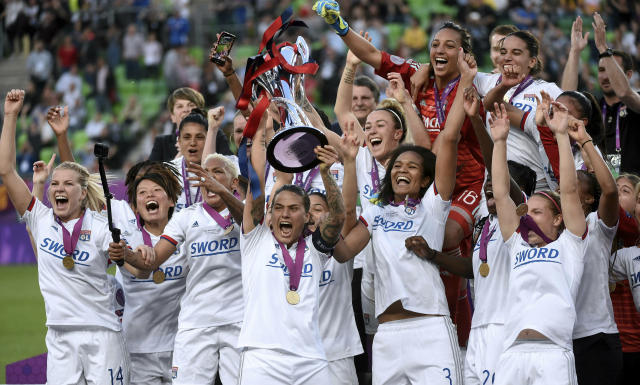 Players of Olympique Lyon celebrate with the trophy after the women's soccer UEFA Champions League final match between Olympique Lyon and FC Barcelona at the Groupama Arena in Budapest, Hungary, Saturday, May 18, 2019. Lyon defeated Barcelona by 4-1. (Balazs Czagany/MTI via AP)