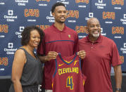 Cleveland Cavaliers first-round draft selection Evan Mobley, center, stands with is parents, Nicol, left, and Eric Mobley during a news conference at the NBA basketball team's training facility in Independence, Ohio, Friday, July 30, 2021. (AP Photo/Phil Long)