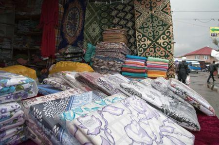 Towels and bed linen produced in Turkmenistan are displayed for sale at a market in Almaty, Kazakhstan April 16, 2019. Picture taken April 16, 2019. REUTERS/Mariya Gordeyeva