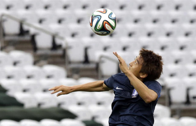 South Korea national soccer team player Koo Ja-cheol heads the ball during an official training session the day before the group H World Cup soccer match between South Korea and Belgium at the Itaquerao Stadium in Sao Paulo, Brazil, Wednesday, June 25, 2014. (AP Photo/Lee Jin-man)