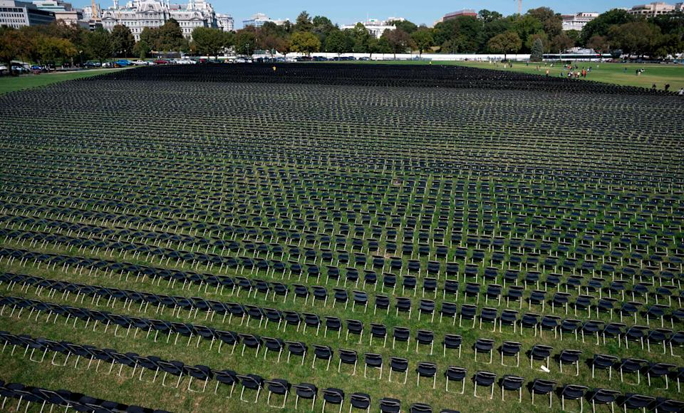 Empty chairs are on display to represent the 200,000 lives lost due to COVID-19 at the National Covid-19 Remembrance, on the ellipse behind the White House in Washington, DC on October 4, 2020.
