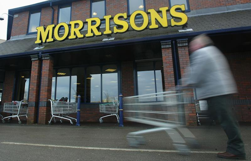 A shopper pushes his cart outside a Morrisons supermarket (Getty Images)
