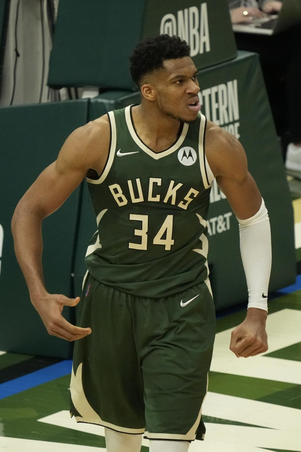 Milwaukee Bucks' Giannis Antetokounmpo reacts after making a shot and being fouled during the second half of Game 1 of the NBA Eastern Conference basketball finals game against the Atlanta Hawks Wednesday, June 23, 2021, in Milwaukee. (AP Photo/Morry Gash)