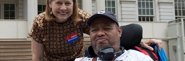 Disability Advocate Gilbert Plaza with HeartShare Executive Director Linda Tempel on the steps of New York City Hall.