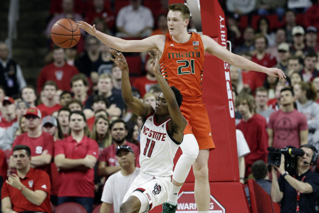 Miami forward Sam Waardenburg (21) blocks North Carolina State guard Markell Johnson (11) during the second half of an NCAA college basketball game in Raleigh, N.C., Wednesday, Jan. 15, 2020. (AP Photo/Gerry Broome)