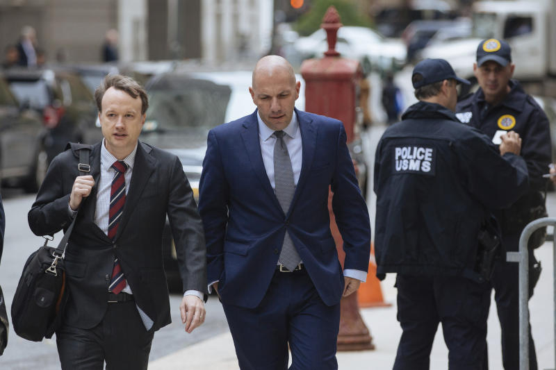 David Correia, center, arrives with his lawyers at federal court, Thursday, Oct. 17, 2019, in New York. Correia and Andrey Kukushkin were set to be arraigned Thursday on charges they conspired with associates of Rudy Giuliani to make illegal campaign contributions. (AP Photo/Kevin Hagen).