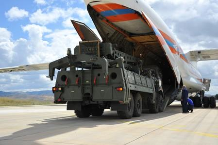 FILE PHOTO: First parts of a Russian S-400 missile defense system are unloaded from a Russian plane at Murted Airport near Ankara