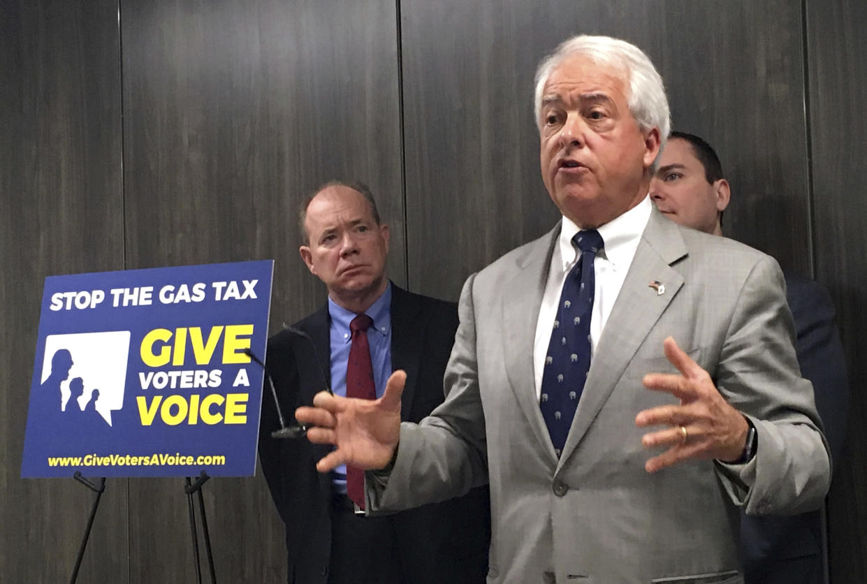 """California Republican gubernatorial candidate John Cox, right, speaks in Sacramento, Calif., in October 2017 about his decision to spend """"significant"""" money on an effort to repeal California's gas and diesel tax increase. Jon Coupal, president of the Howard Jarvis Taxpayers Association, looks on at left. (Photo: Kathleen Ronayne/AP)"""