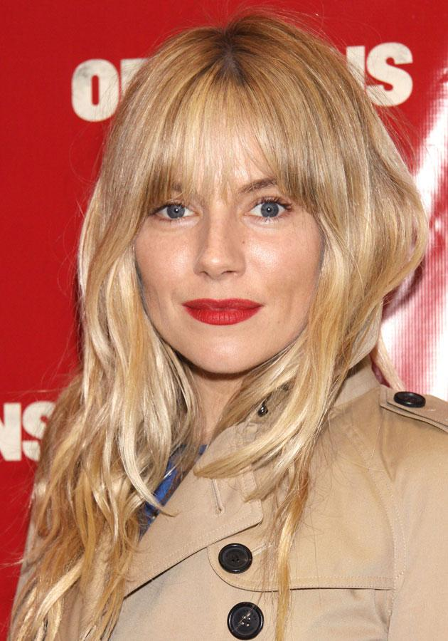 """Celebrities wearing red lipstick: <a href=""""http://uk.lifestyle.yahoo.com/beauty-how-to-sienna-miller-no-make-up-beauty-look--090125365.html"""" data-ylk=""""slk:Sienna Miller;outcm:mb_qualified_link;_E:mb_qualified_link;ct:story;"""" class=""""link rapid-noclick-resp yahoo-link"""">Sienna Miller</a> wore a matte red lipstick on the Orphans red-carpet.<br><br>[WENN]"""