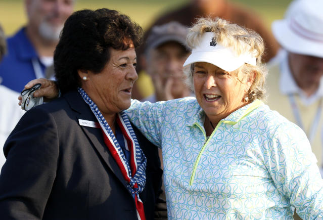Nancy Lopez, left, greets Hollis Stacy during the first round of the inaugural U.S. Senior Women's Open golf tournament in Wheaton, Ill., Thursday, July 12, 2018. (Daniel White/Daily Herald via AP)