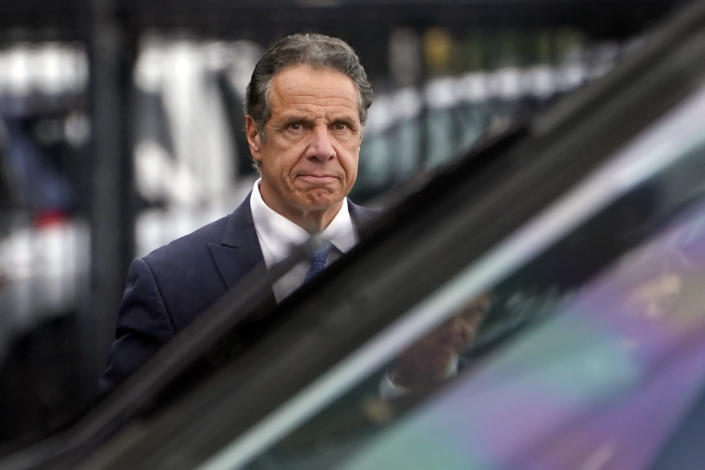 New York Gov. Andrew Cuomo prepares to board a helicopter after announcing his resignation, Tuesday, Aug. 10, 2021, in New York. Cuomo says he will resign over a barrage of sexual harassment allegations. The three-term Democratic governor's decision, which will take effect in two weeks, was announced as momentum built in the Legislature to remove him by impeachment. (AP Photo/Seth Wenig)