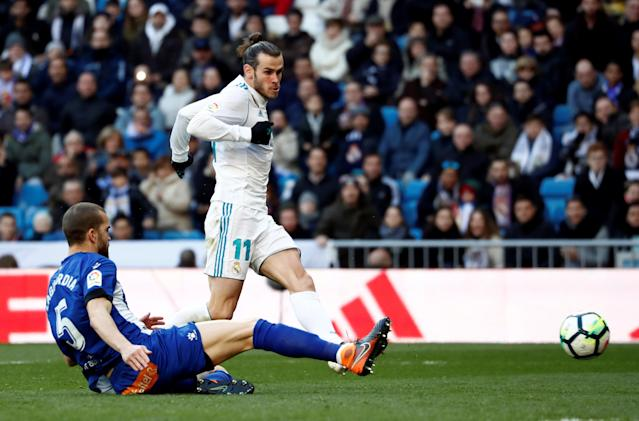 Soccer Football - La Liga Santander - Real Madrid vs Deportivo Alaves - Santiago Bernabeu, Madrid, Spain - February 24, 2018 Real Madrid's Gareth Bale scores their second goal REUTERS/Juan Medina