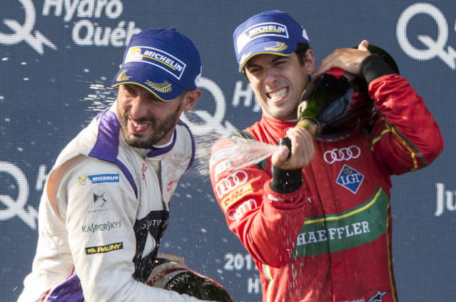 Drivers champion Lucas Di Grassi of Brazil, ABT Schaeffler FE02 (11) sprays race third place finisher Jose Maria Lopez of Argentina, DS Virgin DVS-02 (37) during victory ceremonies at the Montreal Formula ePrix electric car race, Sunday, July 30, 2017 in Montreal. (Paul Chiasson/The Canadian Press via AP)