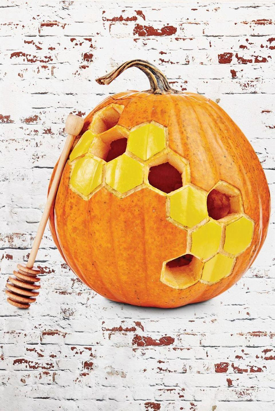 """<p>Go for a naturally sweet design by carving a large honeycomb pattern across the pumpkin's front. Leave a few honeycombs intact and paint them yellow to look like the real thing. </p><p><em><a href=""""https://www.countryliving.com/diy-crafts/g279/pumpkin-carving-ideas/"""" rel=""""nofollow noopener"""" target=""""_blank"""" data-ylk=""""slk:Get the tutorial at Country Living »"""" class=""""link rapid-noclick-resp"""">Get the tutorial at Country Living »</a></em></p>"""