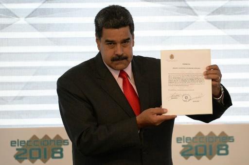 Maduro received his credentials for a second term, which would keep him in office until 2025, from the head of the election commission