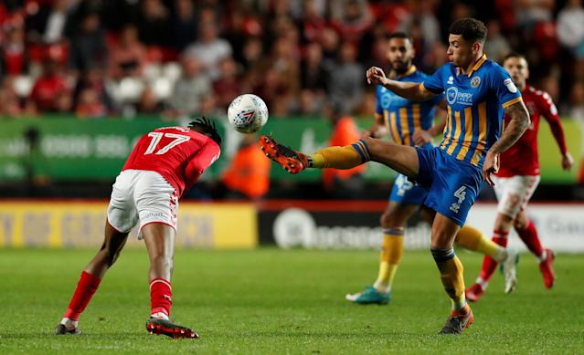 "Soccer Football - League One Play Off Semi Final First Leg - Charlton Athletic vs Shrewsbury Town - The Valley, London, Britain - May 10, 2018 Charlton Athletic's Joe Aribo in action with Shrewsbury Town's Ben Godfrey Action Images/Peter Cziborra EDITORIAL USE ONLY. No use with unauthorized audio, video, data, fixture lists, club/league logos or ""live"" services. Online in-match use limited to 75 images, no video emulation. No use in betting, games or single club/league/player publications. Please contact your account representative for further details."