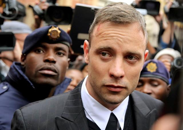 FILE PHOTO: Olympic and Paralympic track star Oscar Pistorius leaves court after appearing for the 2013 killing of his girlfriend Reeva Steenkamp in the North Gauteng High Court in Pretoria, South Africa, June 14, 2016. REUTERS/Siphiwe Sibeko/File Photo