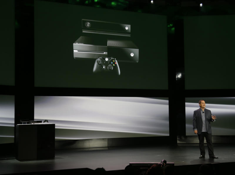 Marc Whitten, Microsoft Corp.'s chief production officer of interactive entertainment, talks about the features of the next-generation Xbox One entertainment and gaming console system, Tuesday, May 21, 2013, at an event in Redmond, Wash. (AP Photo/Ted S. Warren)