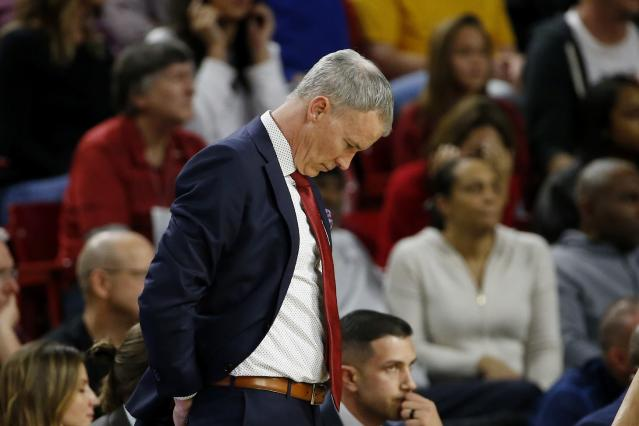 Southern California coach Andy Enfield looks down in the closing moments of the team's 66-64 loss to Arizona State in an NCAA college basketball game Saturday, Feb. 8, 2020, in Tempe, Ariz. (AP Photo/Ross D. Franklin)