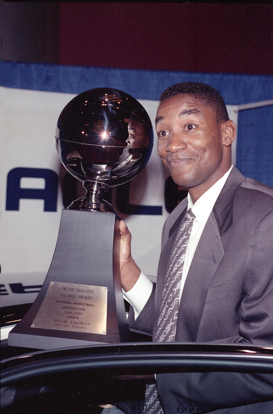 FILE - In this June 20, 1990, filer photo, Detroit Pistons guard and captain Isiah Thomas holds the 1990 NBA Finals Most Valuable Player trophy presented to him during ceremonies in New York. Thomas was famously left off the U.S. Olympic team — the first Dream Team — that won a gold medal at the 1992 Barcelona Olympics with ease. But he could have been an Olympian 12 years earlier, had the Americans not boycotted the 1980 Moscow Games. (AP Photo/Richard Drew, Filer)