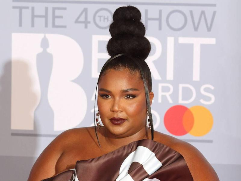 Lizzo cheers up Cardi B with flowers