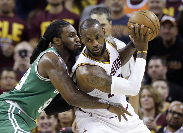 <p>Cleveland Cavaliers' LeBron James, right, backs down Boston Celtics' Jae Crowder (99) during the first half of Game 3 of the NBA basketball Eastern Conference finals, Sunday, May 21, 2017, in Cleveland. (AP Photo/Tony Dejak) </p>