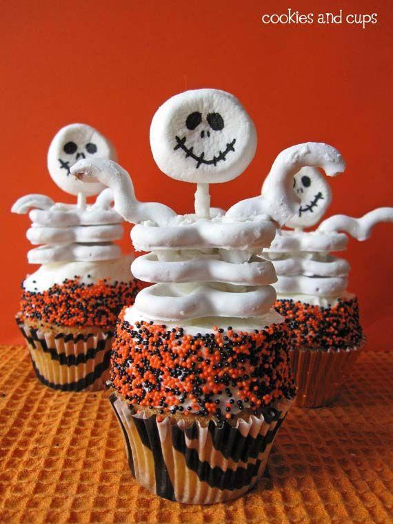 """<p>Who could resist a cute cupcake with a skeletal frame comprised of a marshmallow skull and yogurt pretzel ribs, supported by a lollipop stick? Whip up a batch of these bony characters with your favorite cake mix and canned frosting.<br></p><p><strong>Get the recipe at <a href=""""http://www.womansday.com/food-recipes/food-drinks/recipes/a11450/skeleton-cupcakes-recipe-122708/"""" rel=""""nofollow noopener"""" target=""""_blank"""" data-ylk=""""slk:Woman's Day"""" class=""""link rapid-noclick-resp"""">Woman's Day</a>.</strong></p>"""
