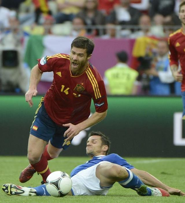 Spanish midfielder Xabi Alonso (L) vies with Italian defender Christian Maggio during the Euro 2012 championships football match Spain vs Italy on June 10, 2012 at the Gdansk Arena. AFP PHOTO / PIERRE-PHILIPPE MARCOUPIERRE-PHILIPPE MARCOU/AFP/GettyImages