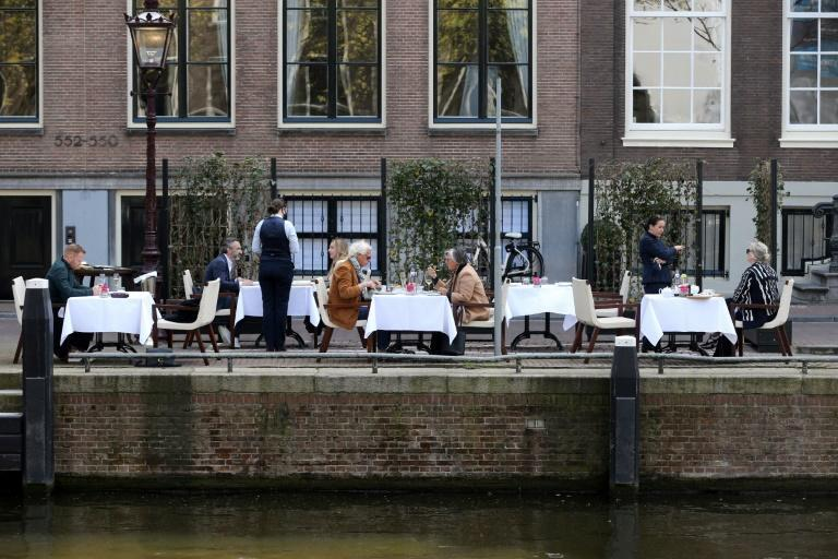 The Dutch feted the end of curfew and the opening of cafe terraces