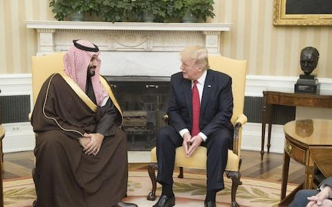 Crown Prince Mohammed bin Salman with Donald Trump - Credit: Donaldson Collection