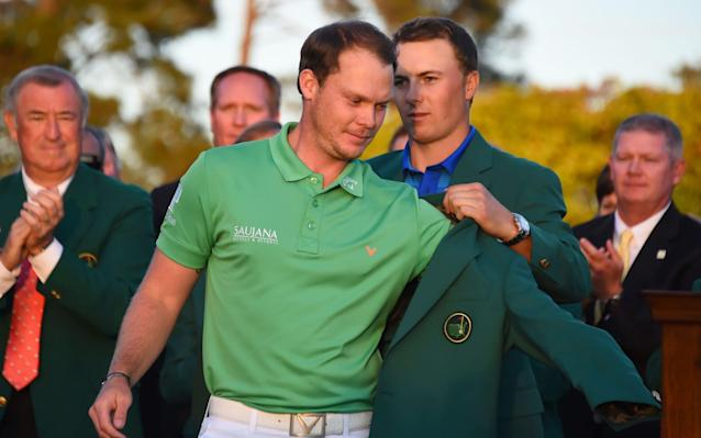 <span>In a cruel twist of fate, runner-up and defending champion Spieth was the man to present Willett with his green jacket in 2016</span> <span>Credit: Jim Watson/AFP/Getty </span>