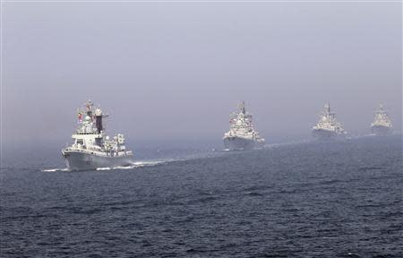 Chinese missile destroyers navigate during the fleet's review of the China-Russia joint naval exercise in the Yellow Sea in this April 26, 2012 file photo. REUTERS/Stringer/Files