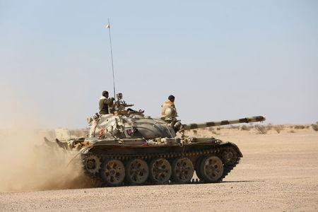 Tank operated by government army moves to shell Houthi positions in al-Labanat area between Yemen's northern provoices of al-Jawf and Marib
