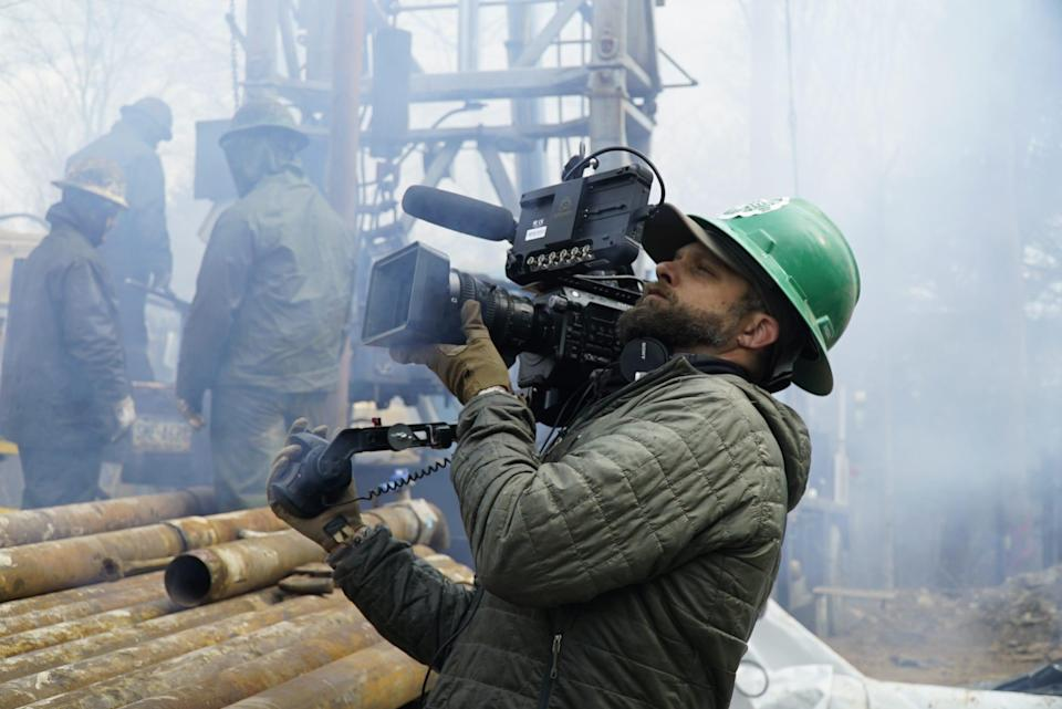 """A cameraman shoots oil workers in """"How America Works."""""""