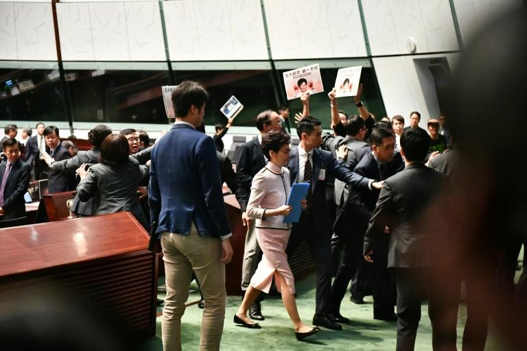 There were chaotic scenes inside Hong Kong's legislature as the city's leader tried to deliver a policy address (AFP Photo/Anthony WALLACE)