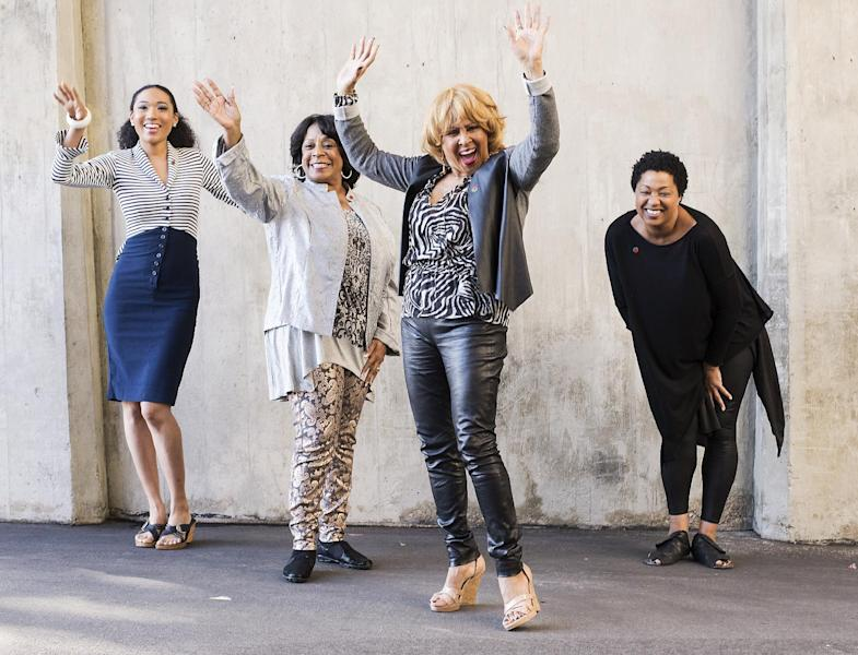 "From left to right, singers Judith Hill, Merry Clayton, Darlene Love and Lisa Fischer pose for a portrait at the Rose Bowl on Tuesday, Dec. 31, 2013 in Pasadena, Calif. The singers are performing the national anthem on Wednesday, Jan. 1, 2014, at the Rose Bowl football game. Hill, Clayton, Love, and Fischer are backup singers featured in the 2013 documentary film, ""20 Feet From Stardom."" (Photo by Dan Steinberg/Invision/AP)"