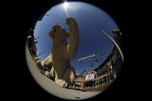 In this photo shot with a fisheye lens, a sculpture of a Tiger is seen in front of Comerica Park before the start of Game 3 of the American League championship series between the Detroit Tigers and New York Yankees Tuesday, Oct. 16, 2012, in Detroit. Detroit leads the series 2-0. (AP Photo/Charlie Riedel)