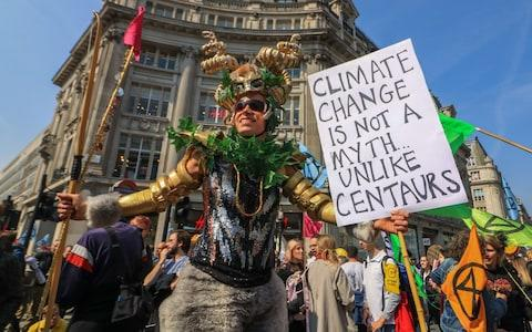 Activists blocked Oxford Street and other busy parts of London to highlight the threat of global warming - Credit: Amer Ghazzal/REX