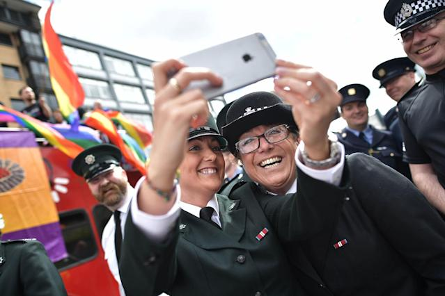 <p>PSNI and Garda officers representative of the gay community take a selfie before taking part in the Belfast Gay Pride parade on Aug. 5, 2017 in Belfast, Northern Ireland. (Photo: Charles McQuillan/Getty Images) </p>