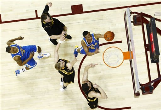 UCLA guard Jerime Anderson (cq) scores on a fast break against Arizona State during an NCAA college basketball game Thursday, Feb. 23, 2012, in Tempe, Ariz. (AP Photo/The Arizona Republic, Rob Schumacher) MARICOPA COUNTY OUT MAGS OUT NO SALES