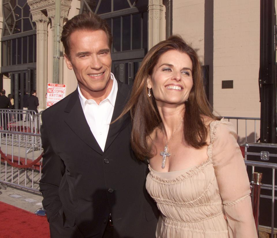 """Arnold Schwarzenegger and Maria Shriver at the 20th anniversary premiere of """"E.T. The Extra-Terrestrial"""" at the Shrine Auditorium in Los Angeles, Ca. Saturday, March 16, 2002. Photo by Kevin Winter/Getty Images"""