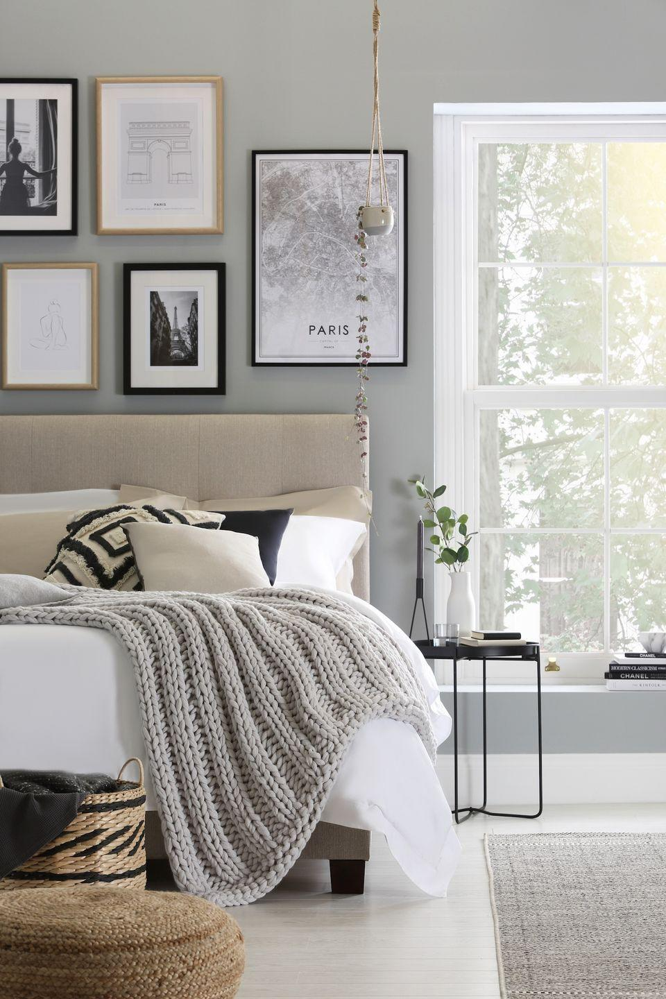 """<p>Use artwork to introduce grey into your bedroom. Use black and white images and place the frames together in a grid above the bed, choose different sizes and you could even mix up the frames – black, white and natural – for an eclectic look. Then build on the look with a grey chunky throw, rug and black and cream cushions. </p><p>Top Tip: Make sure the spacing between the frames is even and not too far apart, 4-5cm is a good gap.</p><p>Pictured: Walkworth bed, <a href=""""https://go.redirectingat.com?id=127X1599956&url=https%3A%2F%2Fwww.furniturechoice.co.uk%2Fbedroom%2Fbed-collections%2Fwalkworth%2F&sref=https%3A%2F%2Fwww.housebeautiful.com%2Fuk%2Fdecorate%2Fbedroom%2Fg35432015%2Fgrey-bedroom-ideas%2F"""" rel=""""nofollow noopener"""" target=""""_blank"""" data-ylk=""""slk:Furniture & Choice"""" class=""""link rapid-noclick-resp"""">Furniture & Choice</a>. Find prints and frames at <a href=""""https://desenio.co.uk/"""" rel=""""nofollow noopener"""" target=""""_blank"""" data-ylk=""""slk:Desenio"""" class=""""link rapid-noclick-resp"""">Desenio</a>.</p>"""