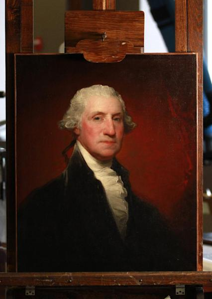 This photo taken June 18, 2012 shows a restored painting of George Washington, by painter Gilbert Stuart inside the Painting Conservation Lab at the National Gallery of Art in Washington. Sixteen paintings by American artist Gilbert Stuart of some of the nation's founding fathers and other figures are showing their true colors for the first time in decades through a major conservation project at the National Gallery of Art. (AP Photo/Jacquelyn Martin)